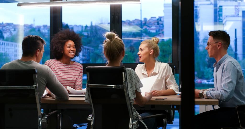storyblocks-multiethnic-startup-business-team-on-meeting-in-modern-night-office-interior-brainstorming-working-on-laptop_SO8FzwIdhb