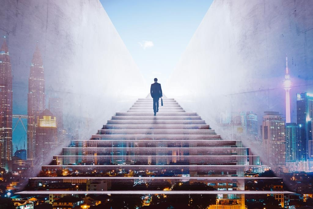 graphicstock-rear-view-of-a-businessman-climbing-stairs-to-get-to-a-large-city-center-concept-of-success-and-appreciation-double-exposure_HdIPxnwejx
