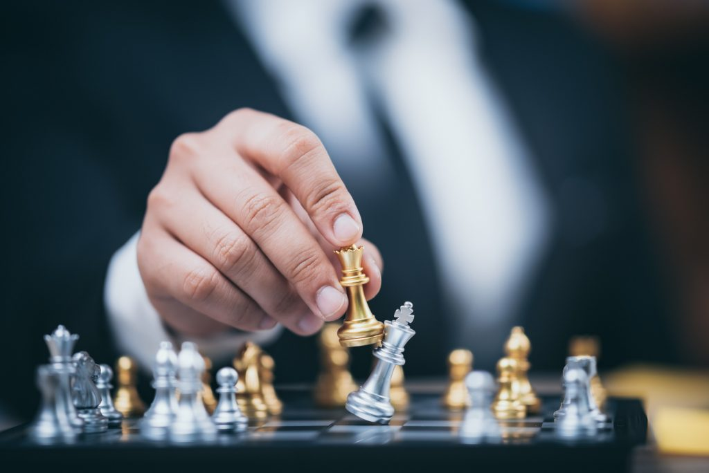 hand-of-businessman-moving-chess-figure-in-competi-2021-04-06-22-09-00-utc-1-1024x684